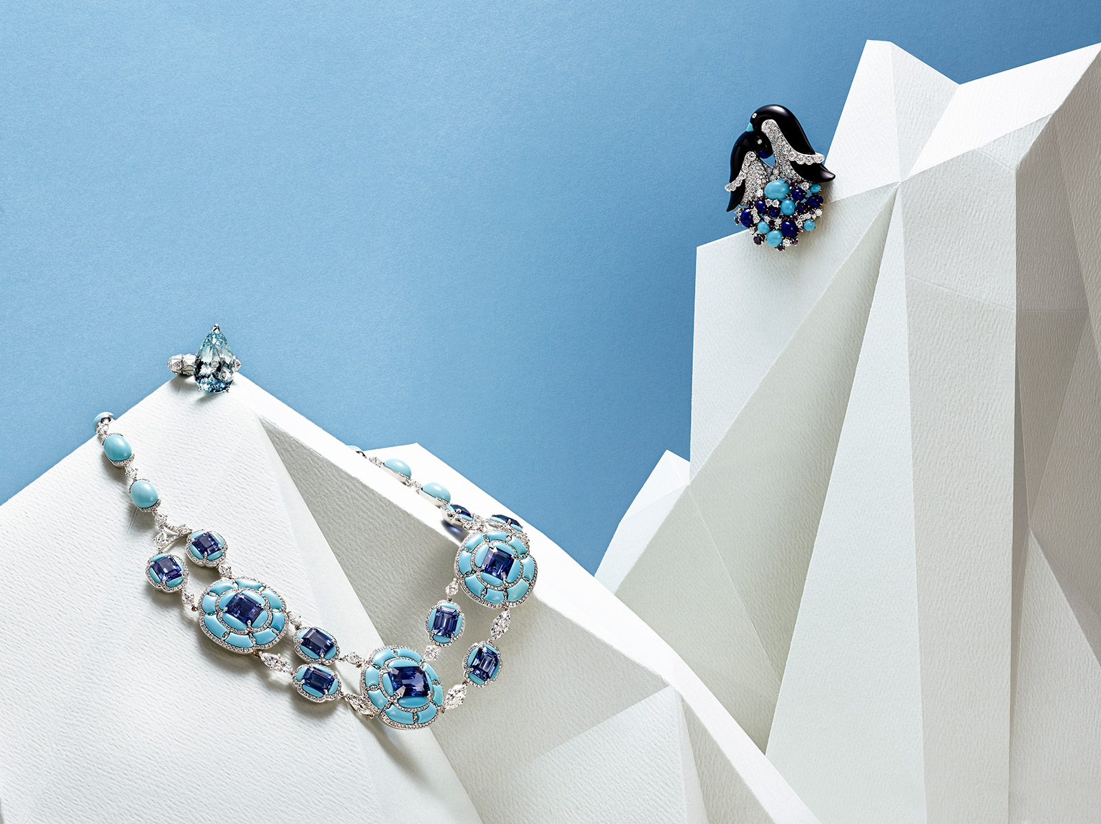 From left to right: Boghossian necklace with ceylon sapphires, turquoise and diamonds in white gold, Sarah Ho 'Pear Drop' ring with 16.30ct aquamarine, diamonds and white enamel on white gold, Van Cleef&Arpels 'Penguins' clip with turquoise, lapis lazuli, sapphires, onyx and diamonds in yellow and white gold