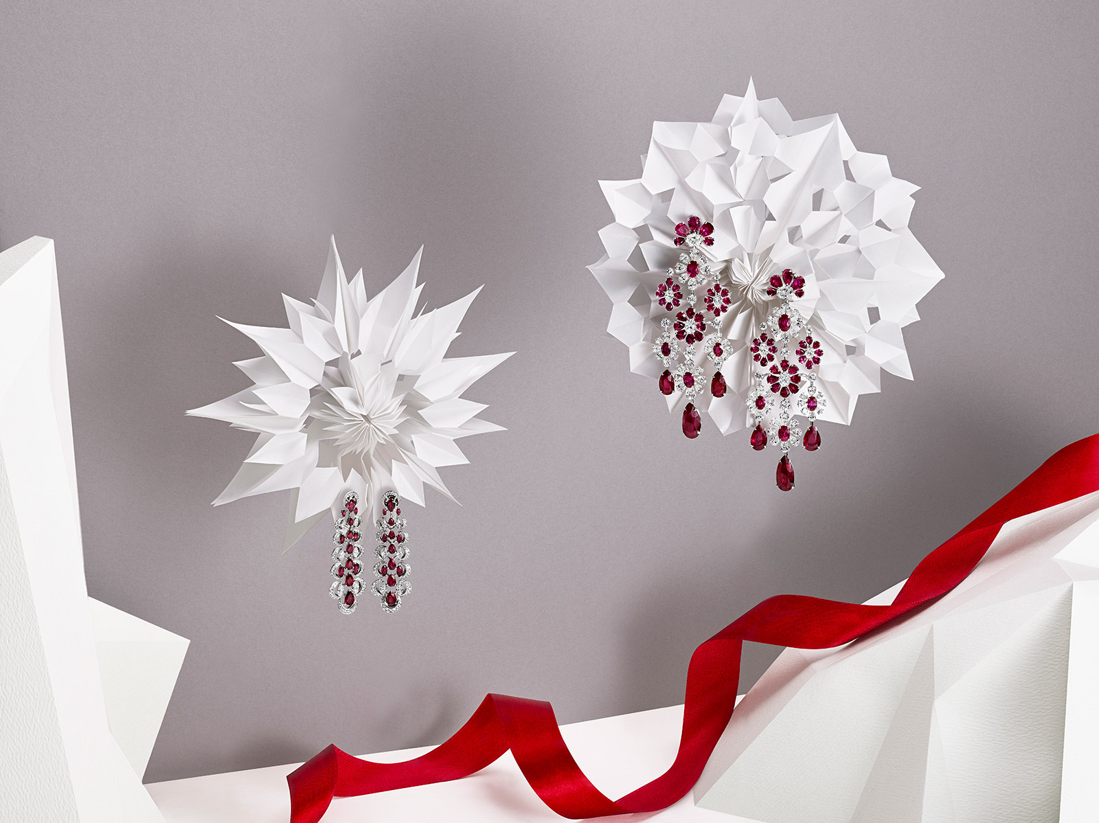 Left to right: Chopard Haute Joaillerie collection earrings with 6.75ct rubies and diamonds in white gold, and David Morris earrings with diamonds and rubies in white gold