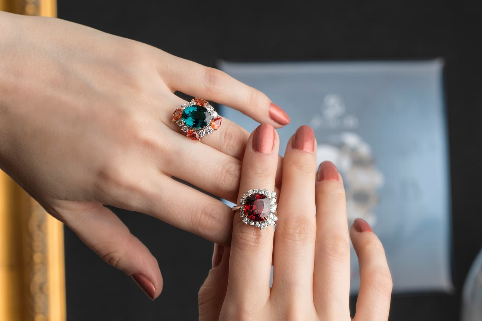 Left: blue tourmaline ring with padparadscha sapphires and diamonds, right: spessartite garnet ring with diamonds by Jessie Foo