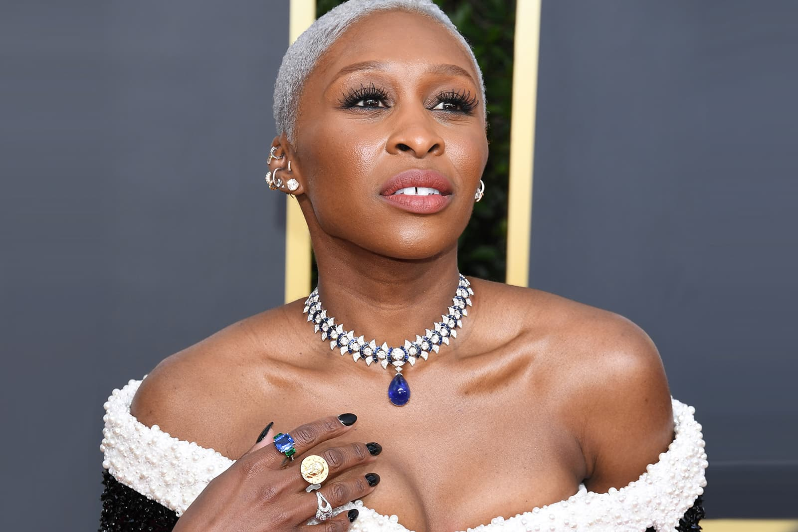 Cynthia Erivo wearing a Bulgari necklace with 40ct cabochon sapphire, and 56.65ct of accenting diamonds and sapphires, diamond earrings and a selection of rings
