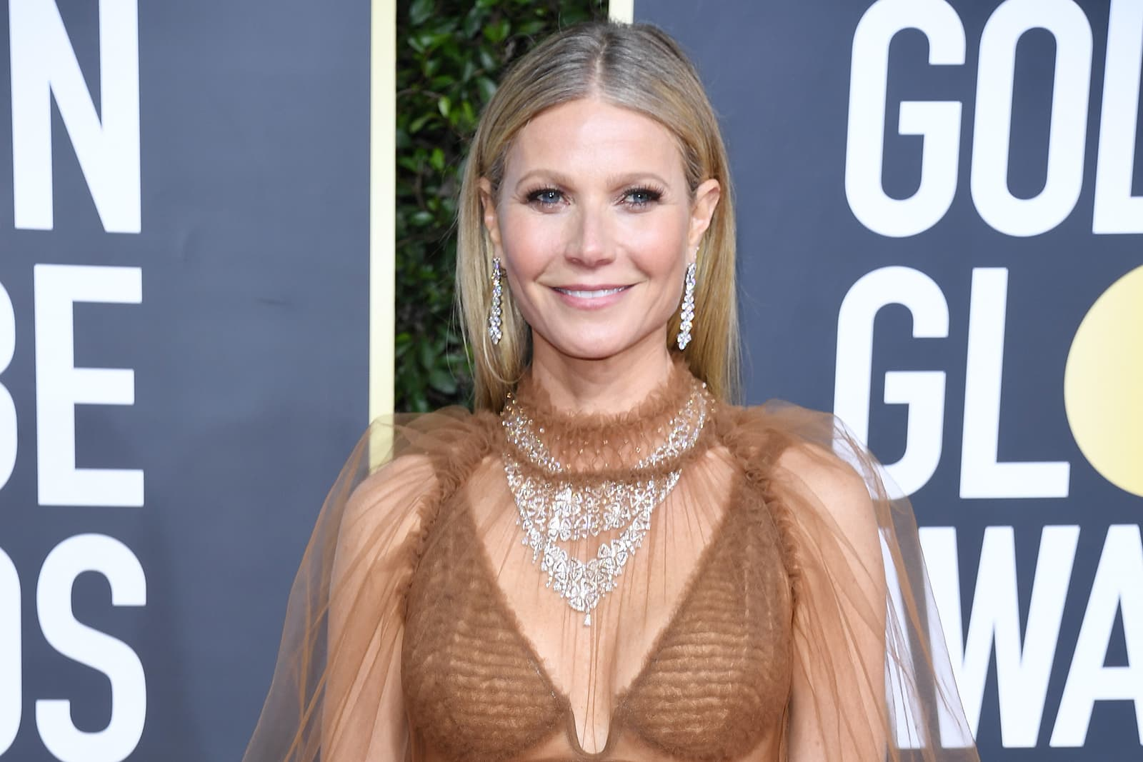 Gwyneth Paltrow wearing two Bulgari Fiorever collection necklaces, High Jewellery earrings and rings totaling almost 100ct of diamonds