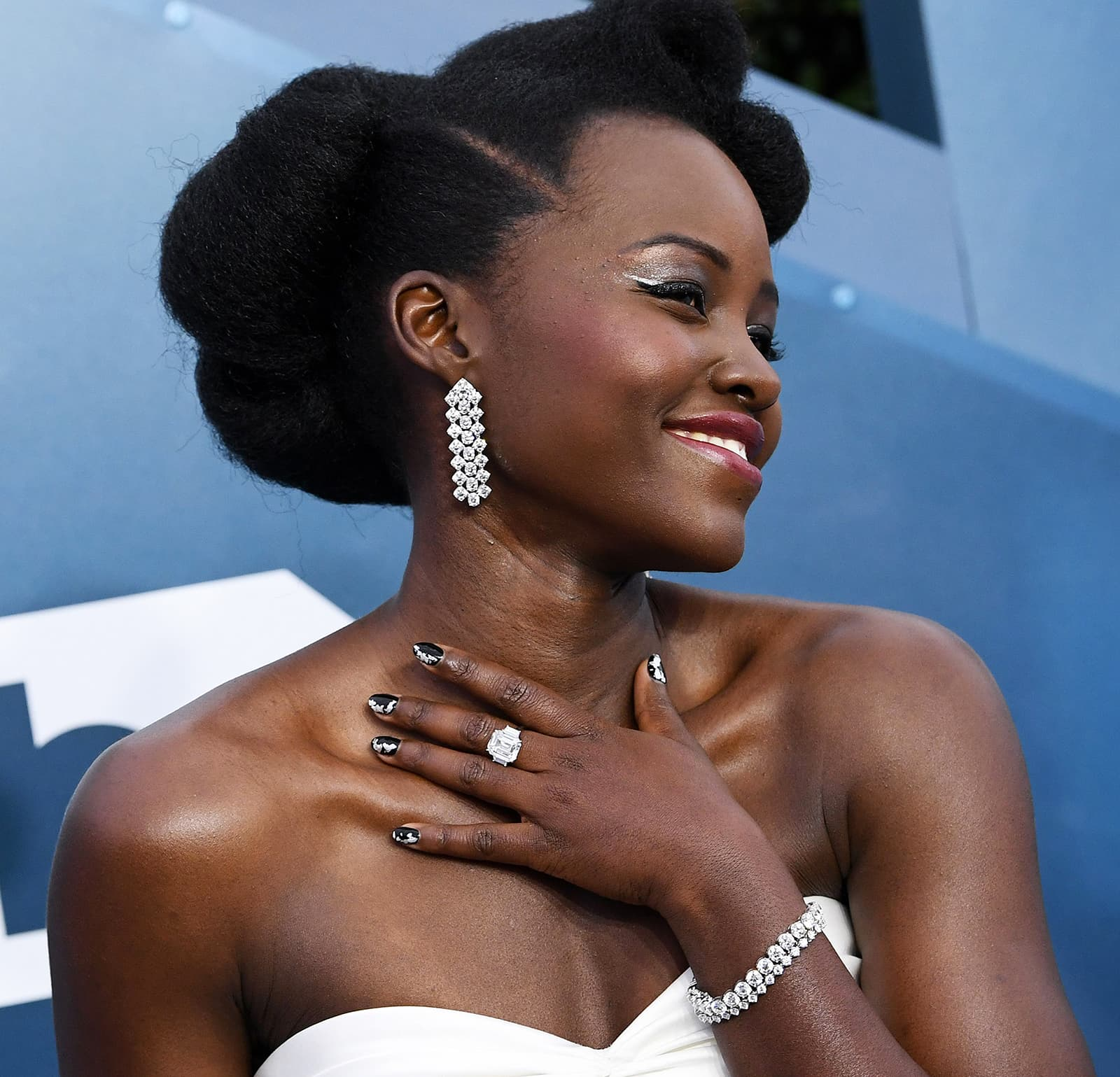 Lupita Nyong'o wearing Forevermark chandelier earrings, bracelet and ring with diamonds totaling 90ct
