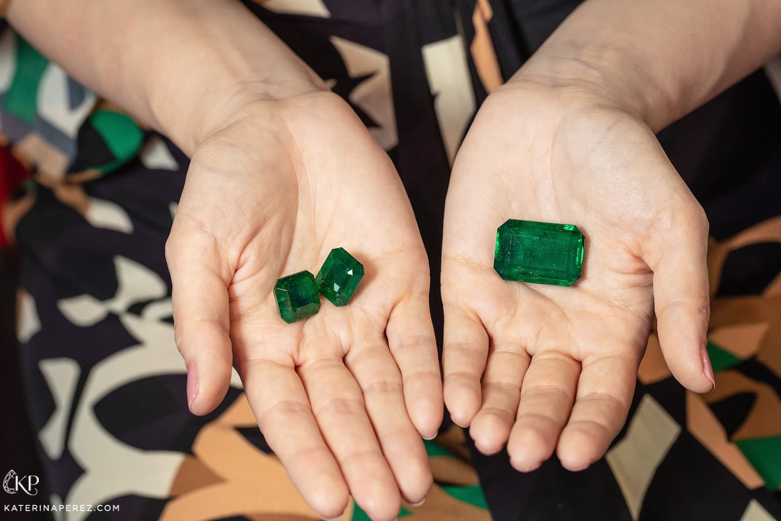 Zambian emeralds, a pair totalling 80 cts and a 128 cts gem, available at P&P Gems. Photo by Simon Martner