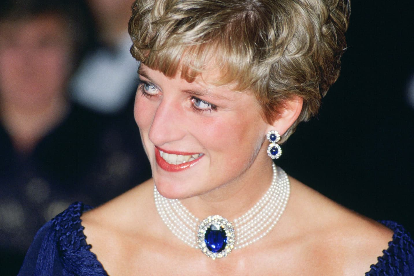 Princess Diana wearing her seven strand pearl choker with sapphire and diamond clap, and earrings with sapphires and diamonds