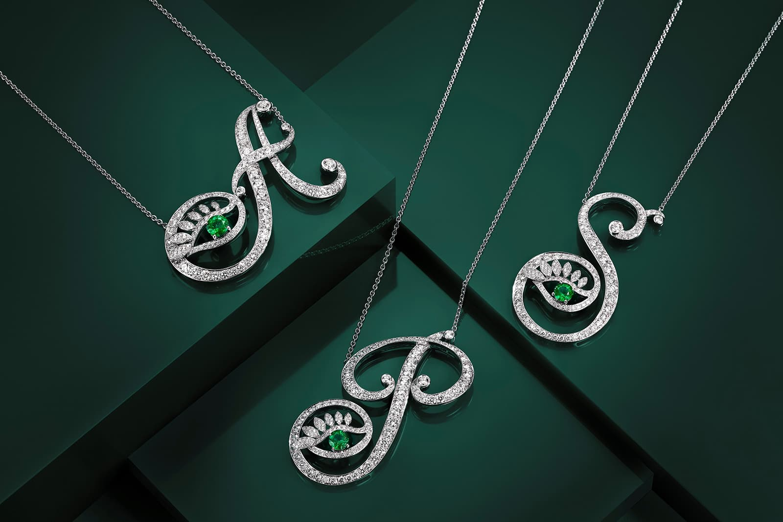 Tabayer alphabet pendants with emeralds and diamonds in white gold
