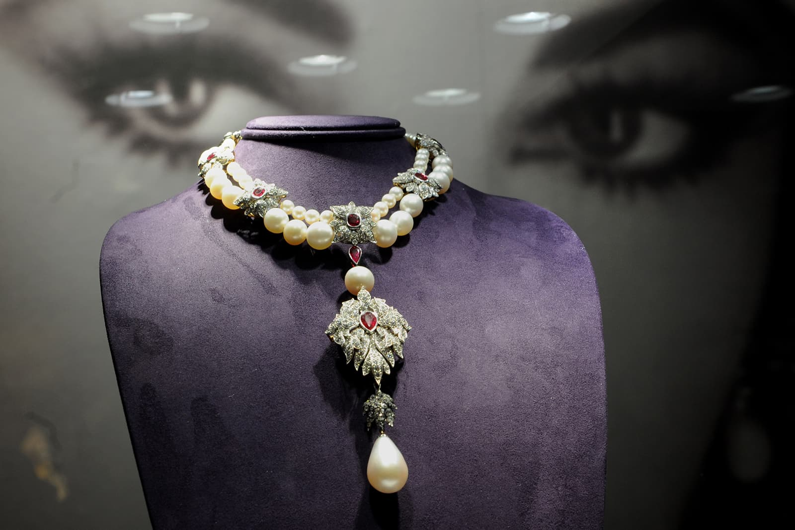 Elizabeth Taylor's La Peregrina Pearl necklace by Cartier with 55.95ct pear shaped pearl, accenting pearls, diamonds, and rubies