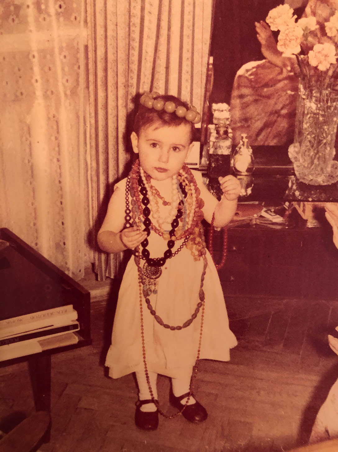 Katerina Perez at 2 years old wearing grandmother's jewellery