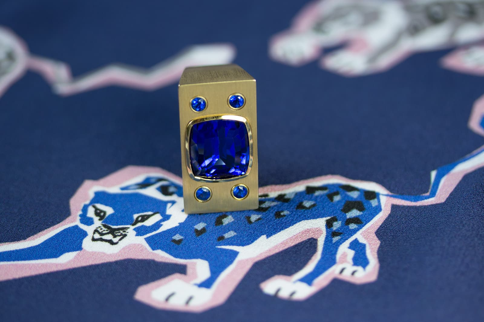 A beautiful tanzanite from Tanzania is paired with rare hauynites in Brummé's M&E ring