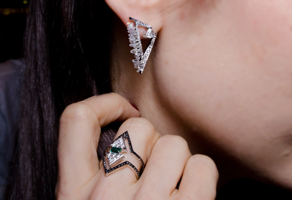 Nikos Koulis ring with emeralds and diamonds and diamond earrings