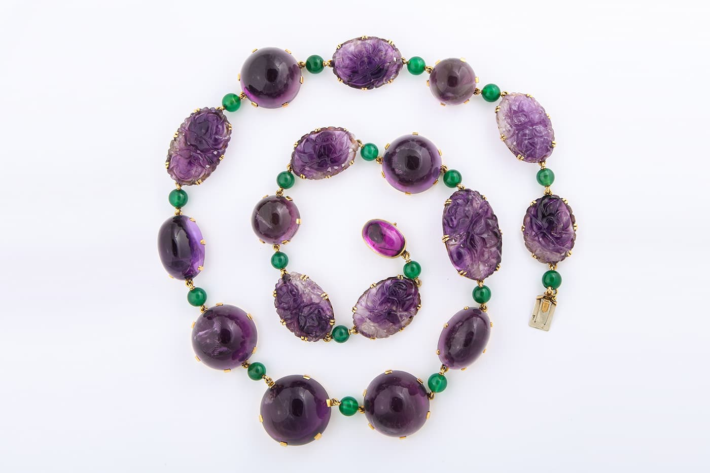 René Boivin 1950s cabochon and carved amethyst necklace and bracelet, interspersed with chrysoprase beads, in 18 carat gold. Sold by A La Vieille Russie