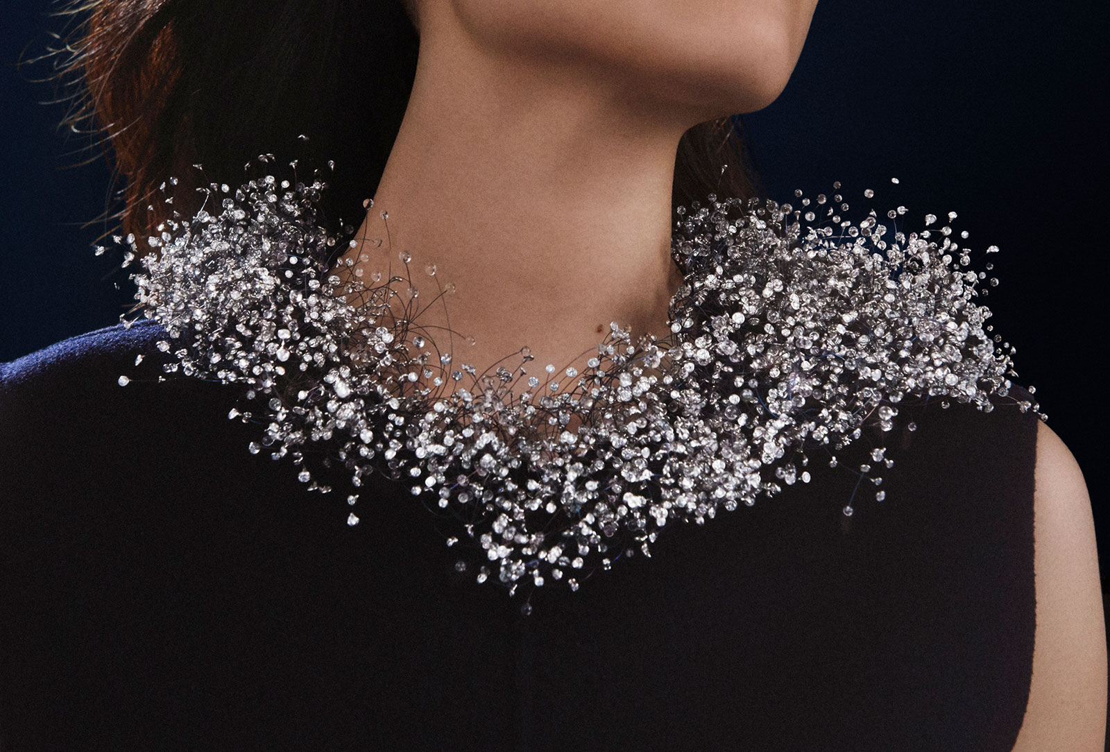 A total of 4,018 diamonds and miniature glass beads were strung on fine titanium threads to create the Nuage en Apesanteur high jewellery necklace