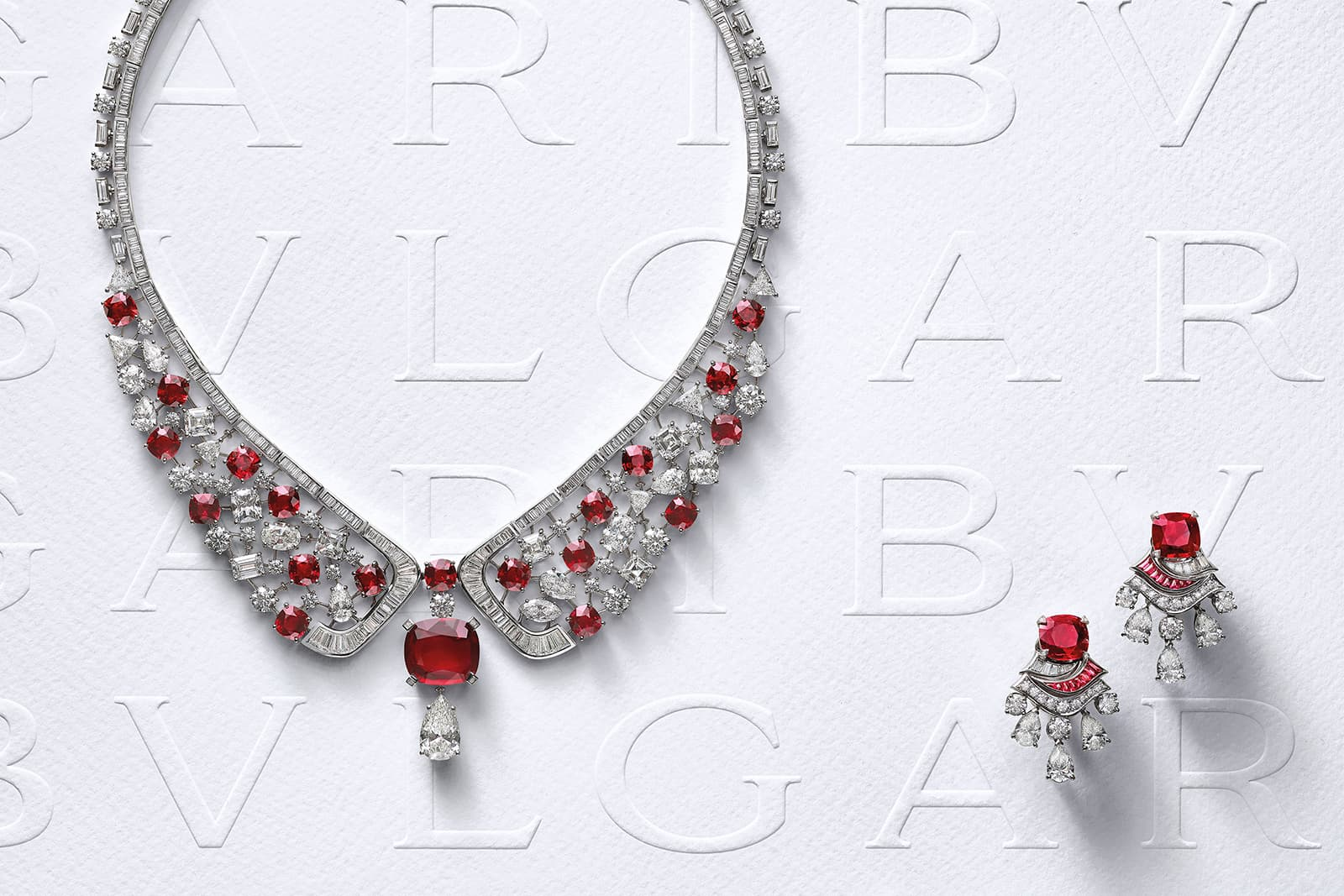 Bulgari's Forever Rubies necklace and earrings. The necklace is set with a rare 10.04 Mozambique ruby accompanied by a spectacular set of 20 vivid red rubies