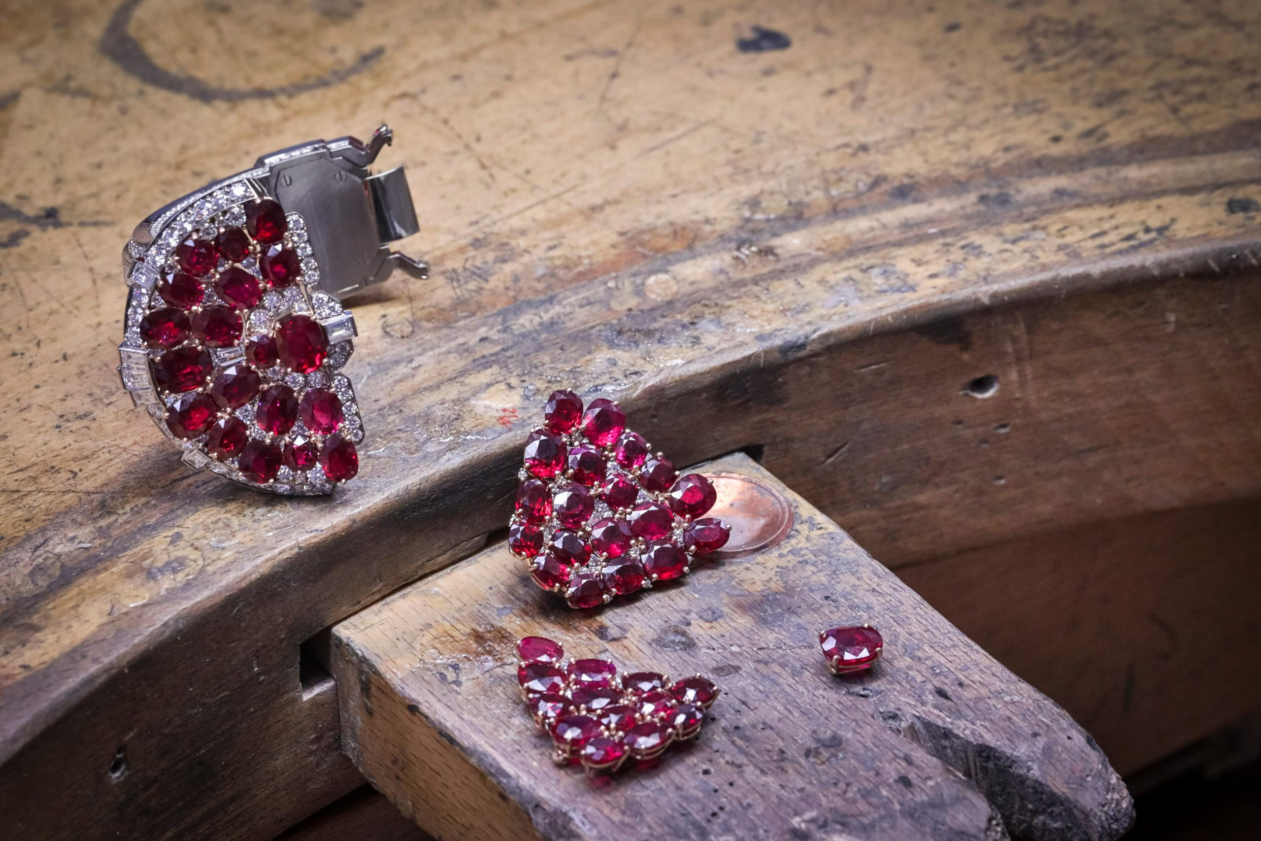 The 72 Burmese rubies in Van Cleef & Arpels' Rubis en Scene high jewellery cuff are set in rose gold prongs to enhance their opulent hue