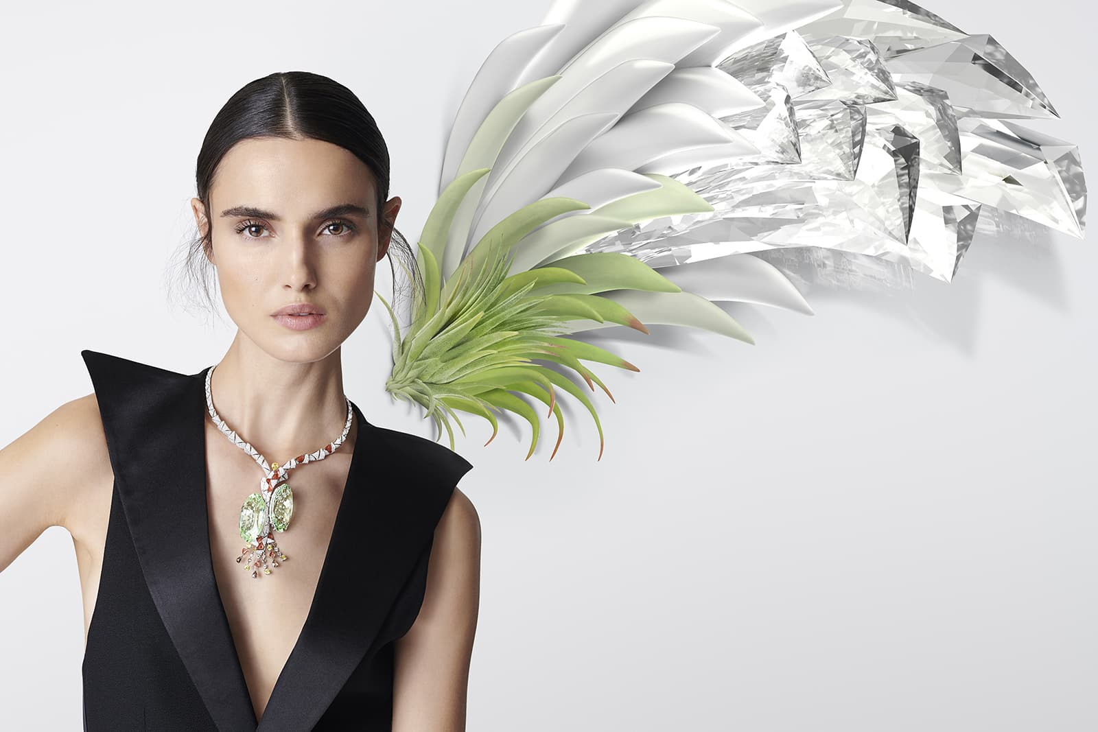 The extraordinary Tillandsia necklace features a pair of oval-shaped beryls weighing 83.23 and 81.09 carats