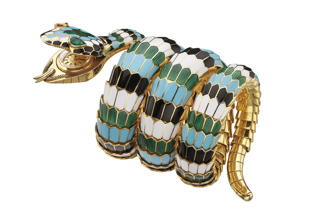 This Bvlgari Serpenti Tubogas bracelet-watch in gold with polychrome enamel and emeralds was designed in 1967