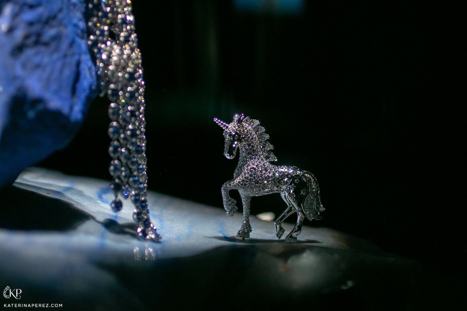 The body of the white gold unicorn shines with round diamonds, while its mane is formed of glittering pear shape diamonds