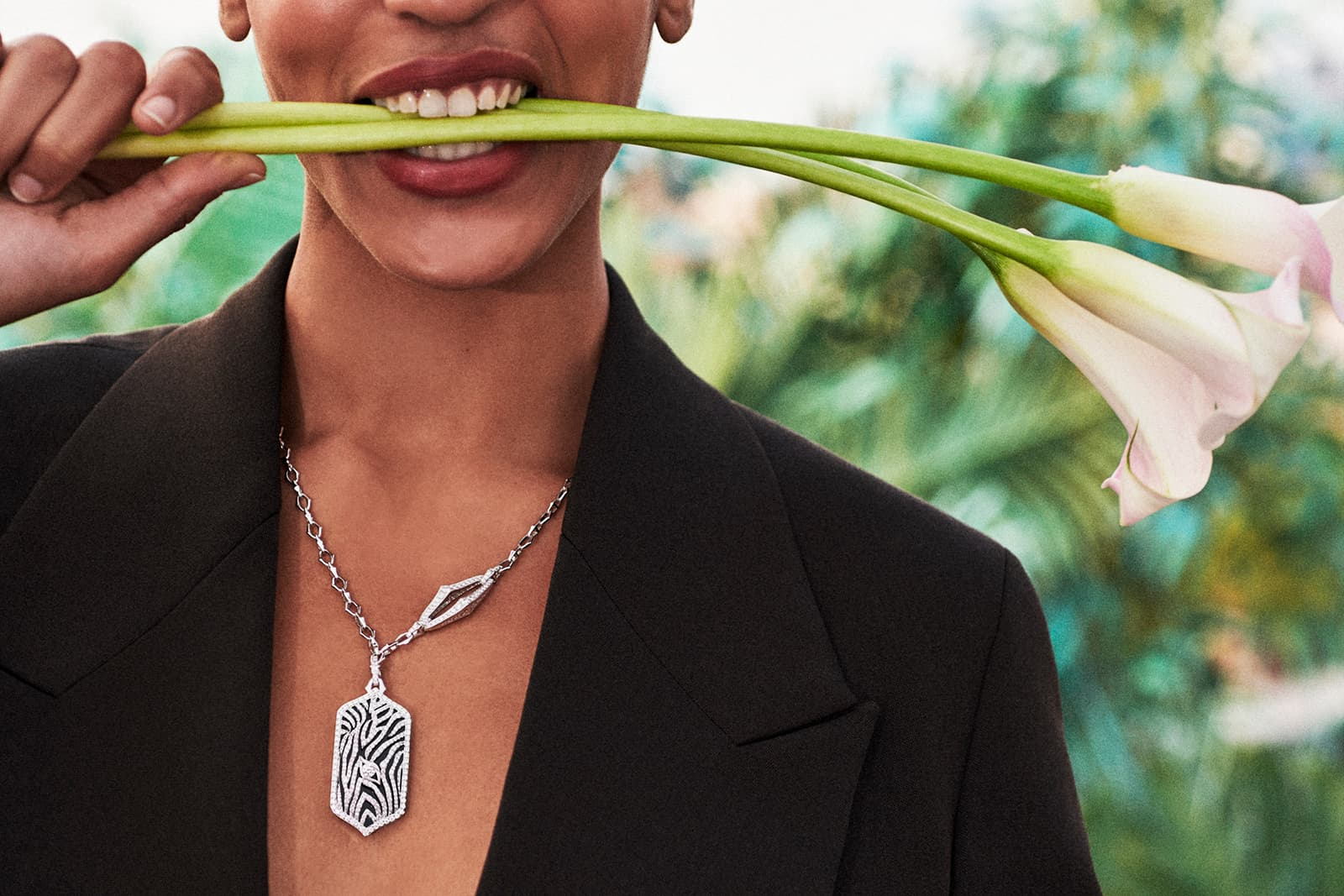 Model Indira Scott wears Sara Weinstock's zebra-inspired pendant