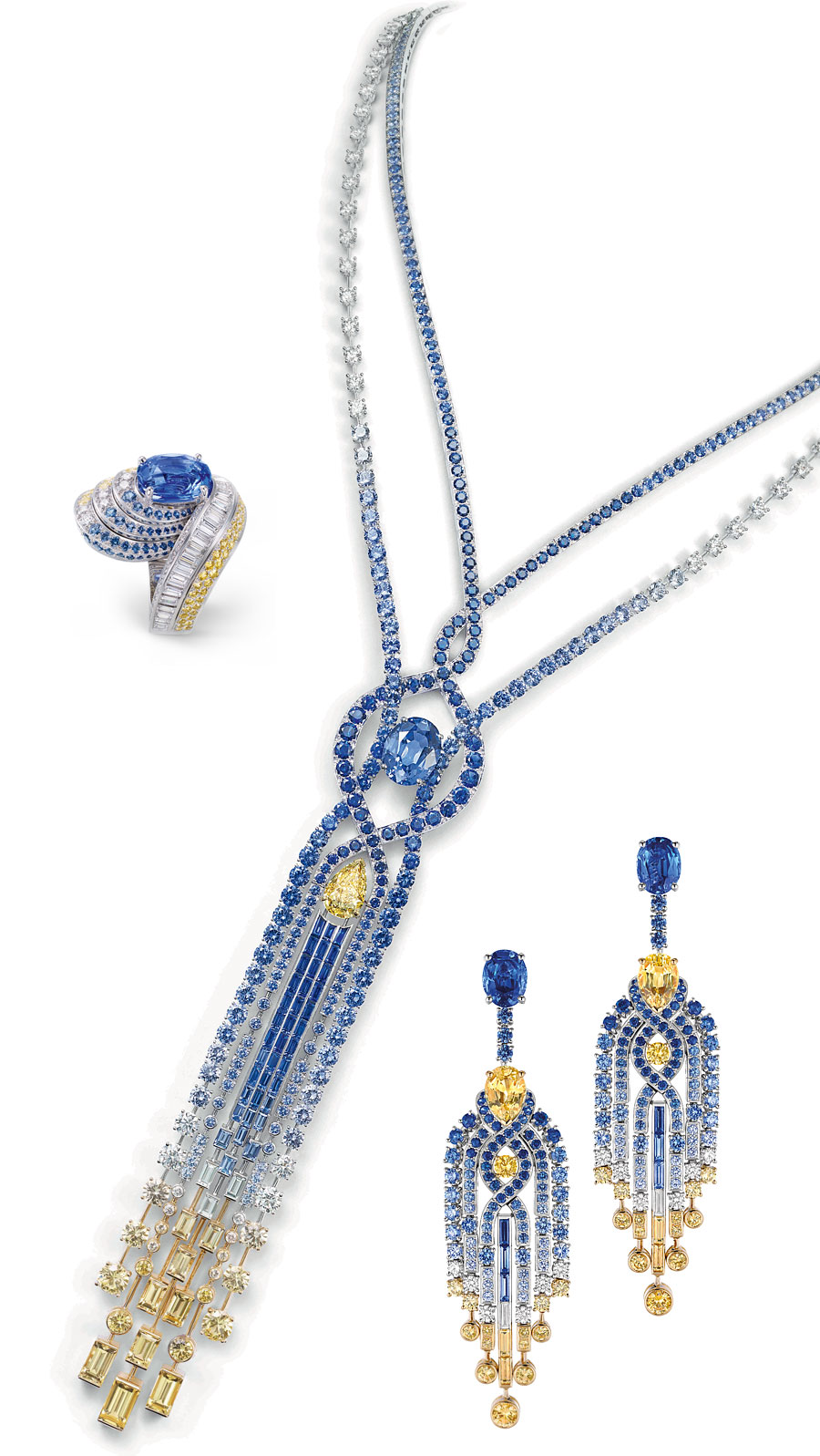 On the right you see a pair of earrings set with diamonds, round and baguette-cut blue and yellow sapphires, two pear-shaped yellow sapphires of 2.23cts and 2.51 cts and two oval-cut blue sapphires from Ceylon, one - 2.72 carats, the other 3.32 carats. The necklace of sapphires and diamonds features a pear-shaped VVS1 Fancy Yellow diamond of 3.77 carats and an oval-cut blue Ceylon sapphire of 10.23 cts. The ring in white gold, set with brilliant-cut, square-cut and baguette-cut diamonds, round blue and yellow sapphires and an oval-cut 5.10 cts sapphire from Madagascar.