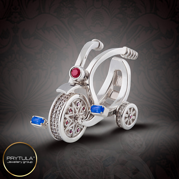 Prytula Bicycle ring with sapphitres, rubies and diamonds