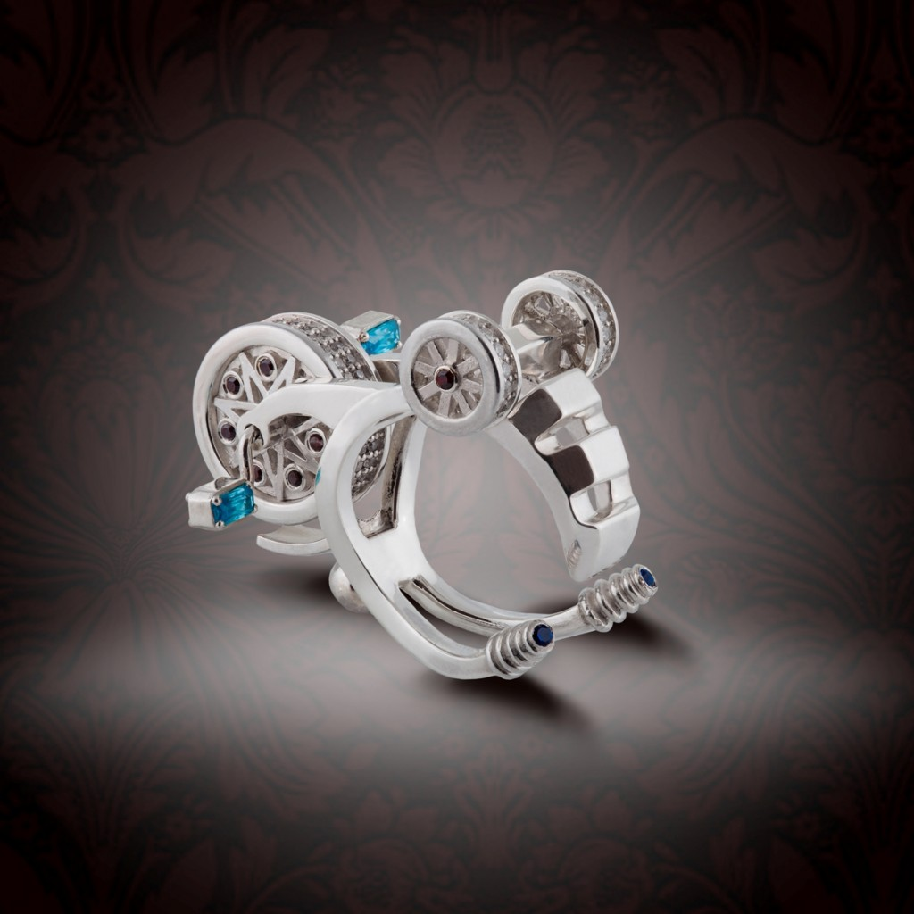 Prytula Bicycle ring with sapphitres, rubies and diamonds upside down