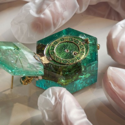 A one-of-a-kind hexagonal emerald watch sits next to the Medusa emerald