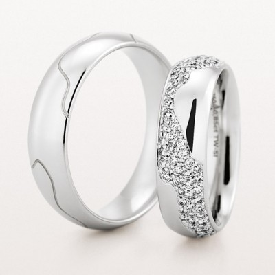 Christian Bauer matching bands for him and her in white gold and diamonds
