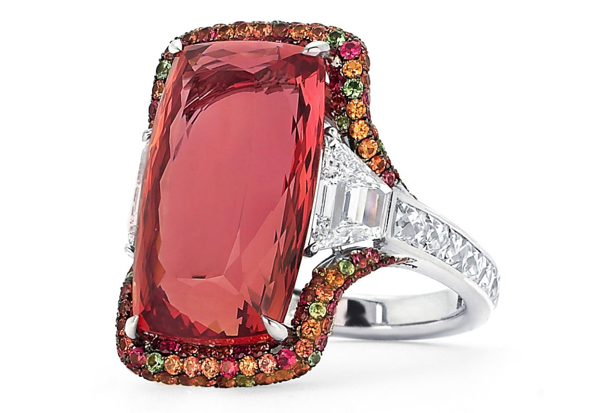 Martin Katz 18 cts imperial topaz ring, with two step-cut trapezoid diamonds and micro-set with diamonds, sapphires, tsavorite garnets and tourmalines.