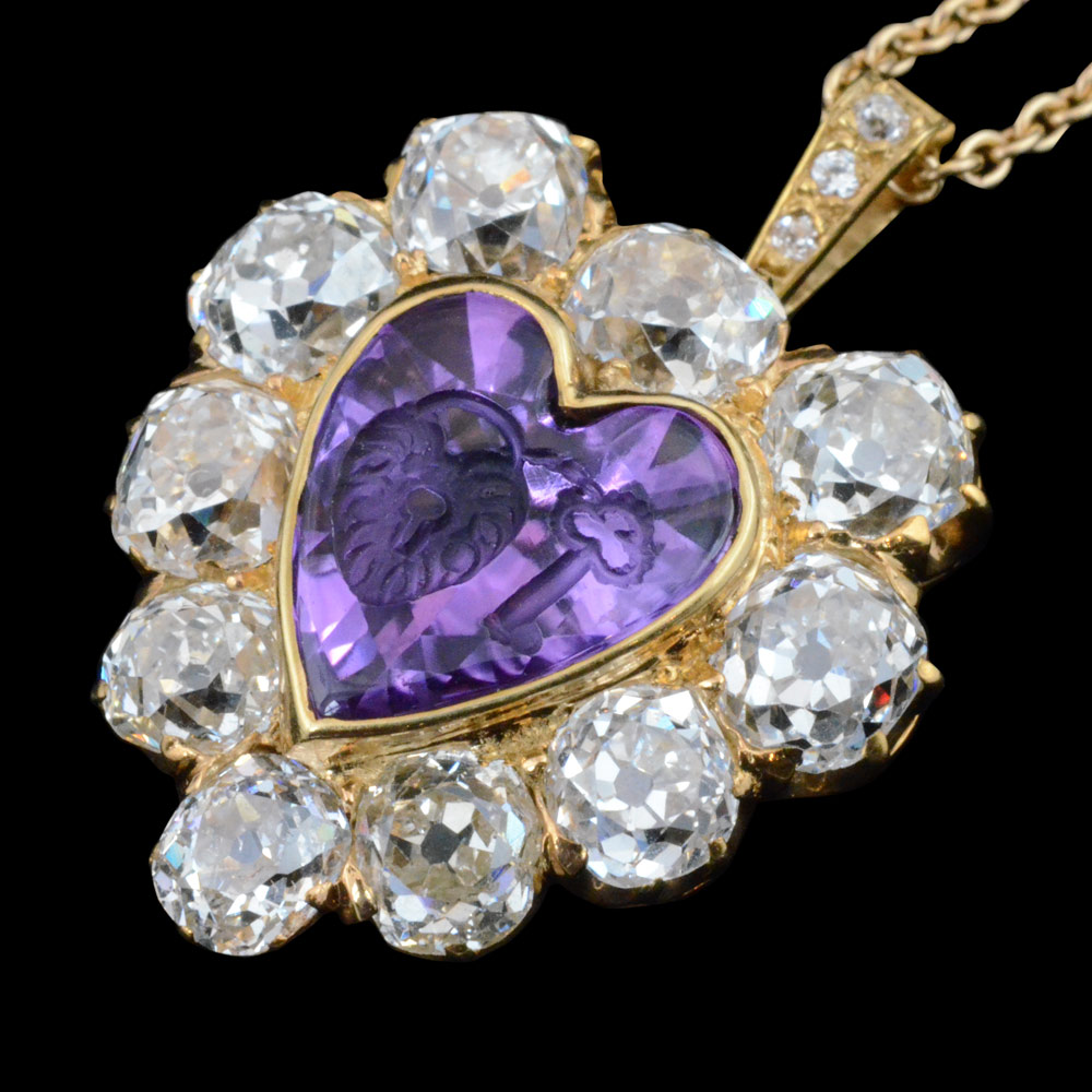 Enchanting amethyst intaglio of key and padlock, signifying 'the key to your heart' and an old mind diamond heart shaped pendant. By Tiffany, New York c1900.
