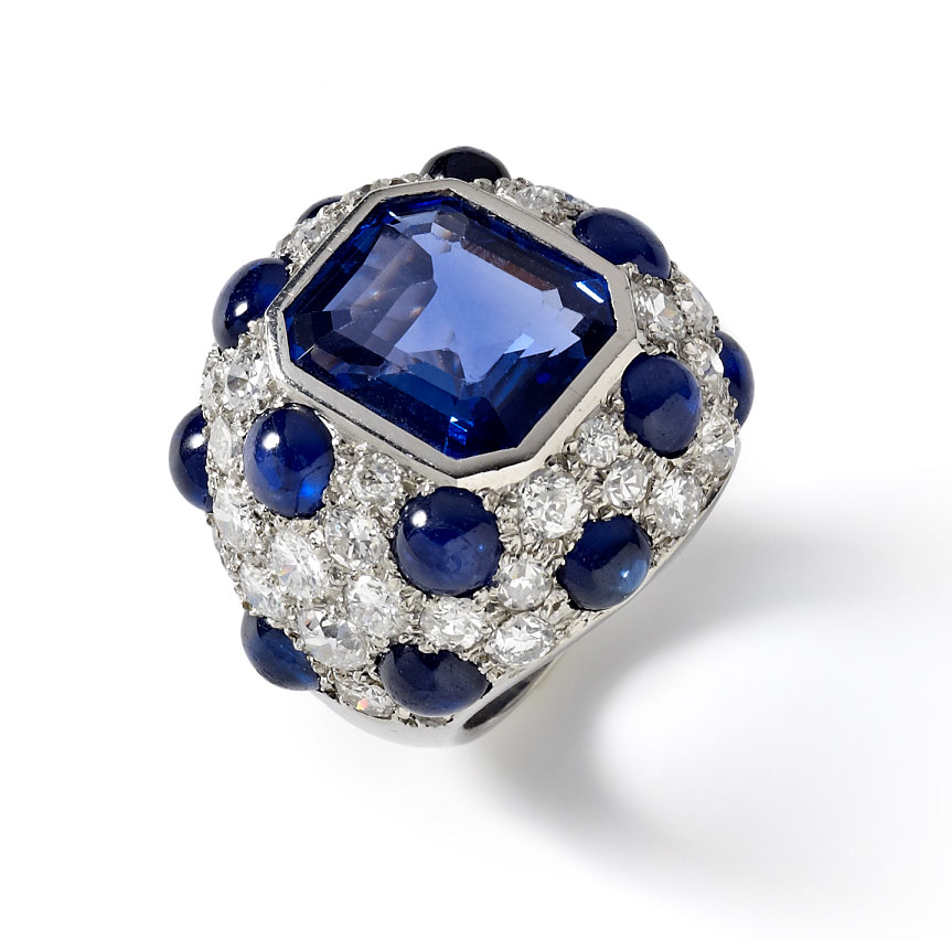 Striking Modele a pois bombe ring mounted in platinum set with sapphires and diamonds by Suzanne Belperron, Paris, C1945