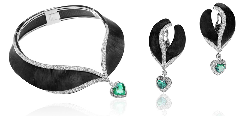 Carbon fiber, heart-shaped emeralds and diamonds set in white gold by Adler