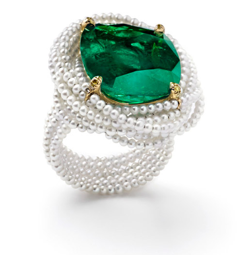 "Suzanne Syz ""La Colombiana perfecta"" ring crafted in yellow gold and titanium. The centre stone is a Colombian Emerald 13.18 cts complemented by 12 Yellow diamonds 0.06 carat"