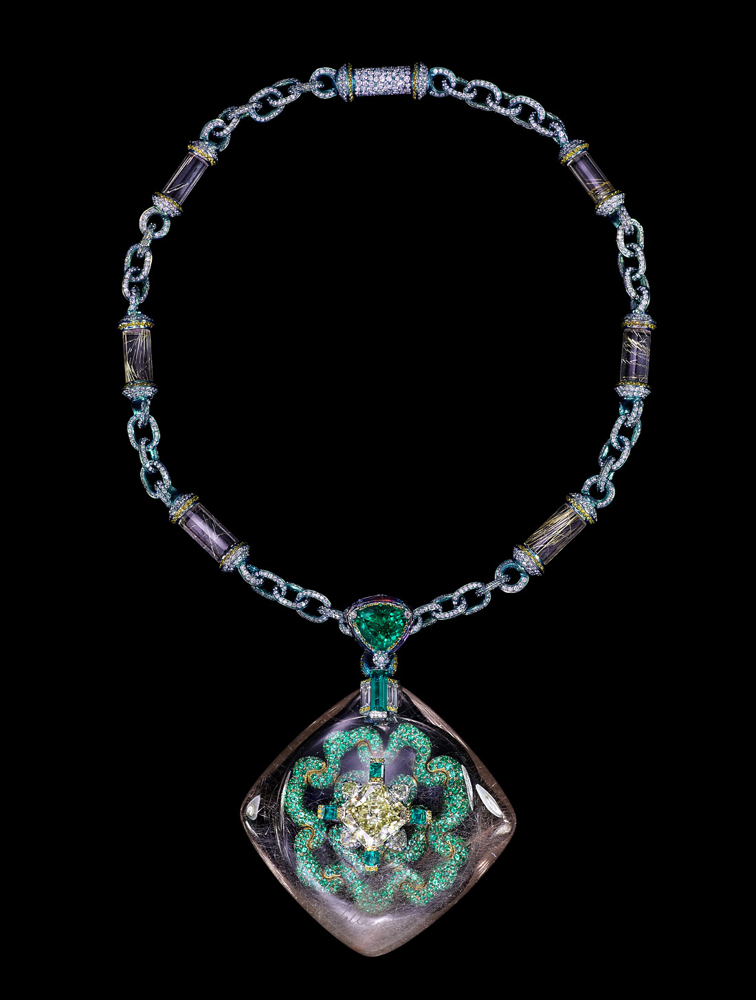 Wallace Chan Secret Abyss necklace with a yellow diamond of 10.05 cts set in a rutilated quartz shell of 211.74ct and complemented with emeralds, fancy colored diamonds, amethysts and rutilated quartz