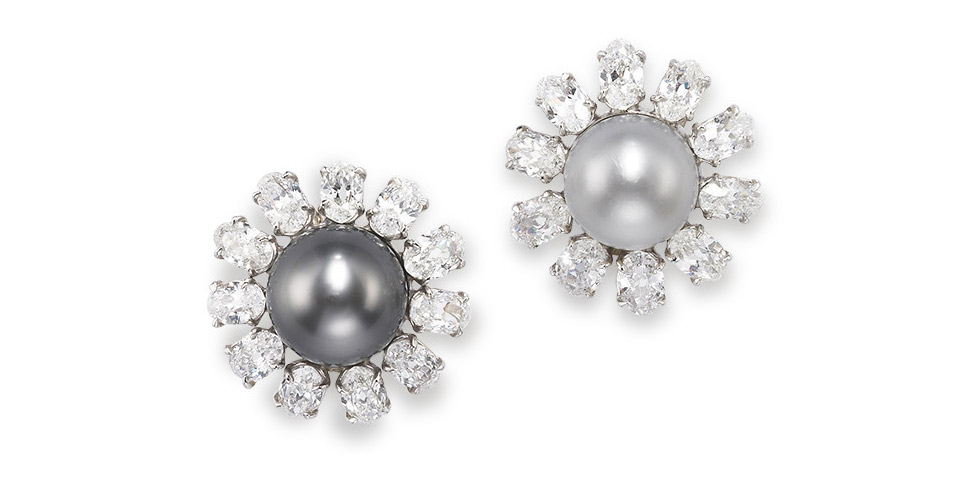 A pair of natural pearl and diamond earrings. Each cluster centring a button-shaped grey natural pearl measuring 11.5 x 12.3mm and a button-shaped white natural pearl measuring 11.0 x 10.4mm. Diamonds approximately 7.25 carats total. Est. $ 160,000 – $ 230,000