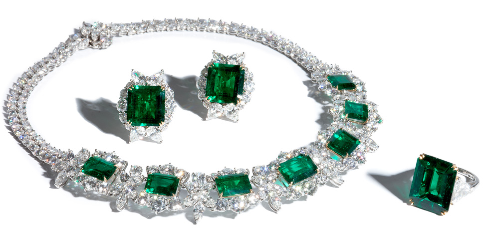 Earrings, ring and necklace with emerald and diamonds, all by Bayco