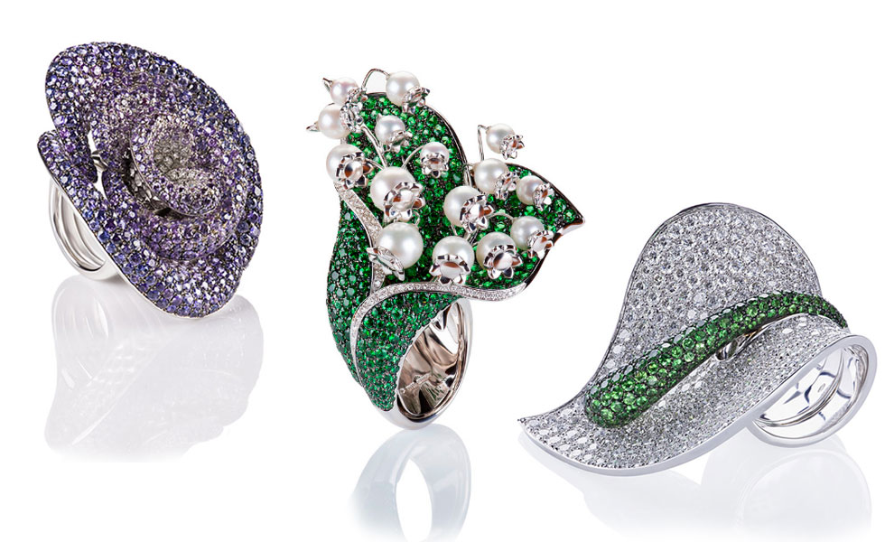 From left to right: Rose ring in white gold with sapphires; Mughetto Ring with pearls, trsavorites and diamonds set in white gold; Anturium ring with tsavorites and diamonds set in white gold