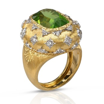Ring with peridot and diamonds in yellow and white gold