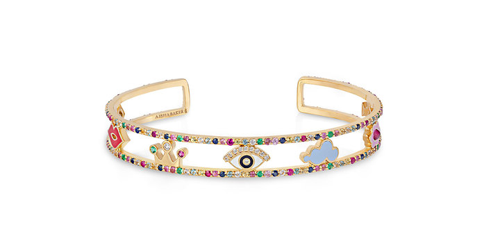 A Charmed Life bangle with enamel, pink, blue and yellow sapphires, aquamarines, emeralds, tourmalines and diamonds