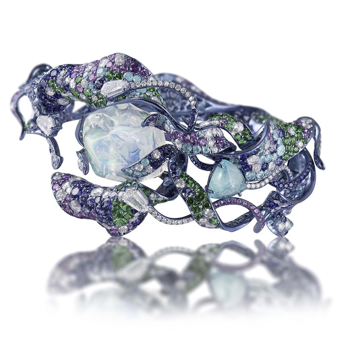 Vruta cuff bracelet made in titanium with a water opal, fancy colour sapphires, tsavorites and diamonds