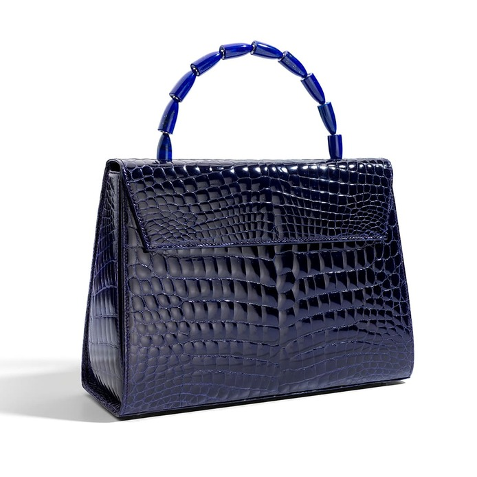 Calla handbag in purple crocodile with handle in lapis and 18K white gold