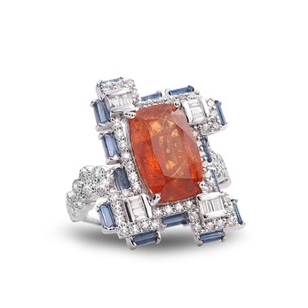 Trinity ring with mandarin garnet, sapphires and diamonds in white gold