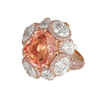 Padparadscha sapphire ring with pink and white diamonds in 18 carat white gold