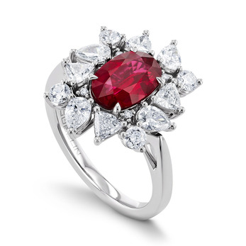 Gübelin ring from the Mystical Garden collection with an oval ruby and diamonds
