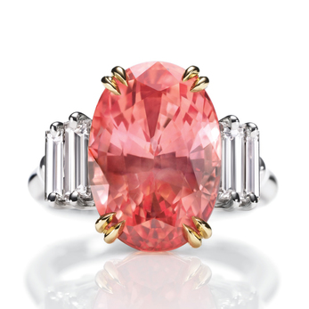 Ring with oval cut 11.41ct Padparadscha sapphire and diamonds in yellow and white gold