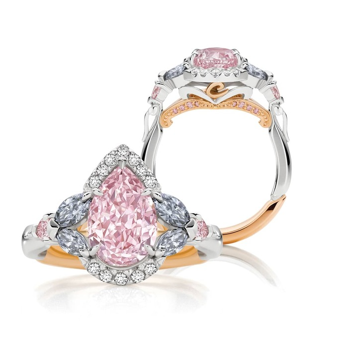 'Tsarina' ring with 2.15ct pear cut fancy intense purplish pink diamond, four marquise cut blue diamonds from the 2012 Argyle Tender, and colourless diamonds, in platinum and 18k rose gold