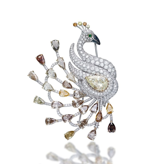 'Pavone Diamanti ' brooch from the 'Exceptional Fauna' collection with  fancy yellow, champagne and colourless diamonds in 18k white gold