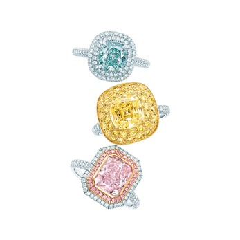 Rings (from top): with cushion-cut fancy intense bluish green diamond in platinum , square antique modified brilliant cut fancy yellow diamond ring with melee diamond border in platinum and 18 karat yellow gold, and cushion mixed-cut fancy intense purplish pink diamond ring with pink diamond in platinum and 18 karat rose gold