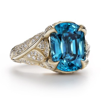 Ring with blue zircon and diamonds in 18k yellow gold